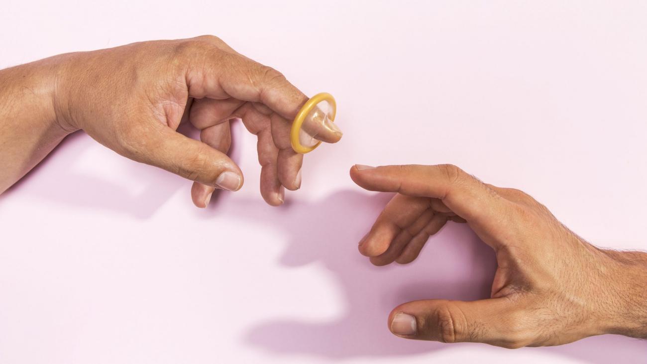 close-up-man-hands-with-transparent-condom